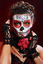 Halloween make up sugar skull beautiful model with perfect hairstyle santa muerte concept Stock Images