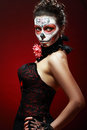 Halloween make up sugar skull beautiful model with perfect hairstyle santa muerte concept Stock Photos