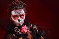 Halloween make up sugar skull beautiful model with perfect hairstyle santa muerte concept Stock Image