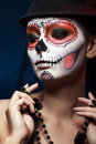 Halloween make up sugar skull girl in hat studio shot Stock Images