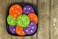 Halloween monster eyeball cookies against rustic wooden background Royalty Free Stock Photo