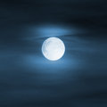Halloween moon bright in blue foggy sky background Stock Photography