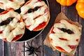 Halloween mummy mini pizzas overhead scene on rustic wood