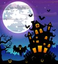 Halloween night background with black ghost and pumpkins and scary castle in graveyard