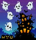 Halloween night background with flying ghost and scary castle in graveyard