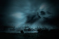 Halloween night spooky image with old european cemetery in a dark with cloudy threatening sky good for Royalty Free Stock Photo