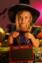 Halloween party with a child holding sign Stock Photography