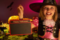 Halloween party with a child holding sign in hand Royalty Free Stock Photography