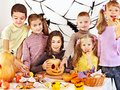 Halloween party with children holding trick or treat group Stock Image