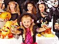 Halloween party with children holding trick or treat group Stock Photo