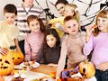 Halloween party with children holding trick or treat group Royalty Free Stock Photo