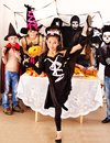 Halloween party with children holding trick or treat group Stock Photography