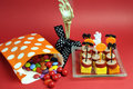 Halloween party food and candy treat bag happy with skeleton hand glass on red background Royalty Free Stock Photography