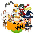 Halloween party a mummy and a witch and a vampire enjoy a while eating many cakes of pumpkin Royalty Free Stock Images