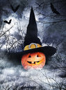 Halloween poster pumpkin witch hat foggy background Stock Image
