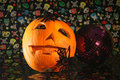Halloween pumkin pumkins face with flowers and candle Royalty Free Stock Photo