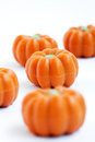 Halloween pumpkin candy colorful group of in shape of pumpkins on white background also useful as autumn concept Stock Photos