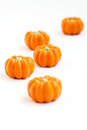 Halloween pumpkin candy colorful group of in shape of pumpkins on white background also useful as autumn concept Stock Photography