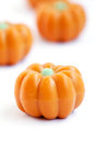 Halloween pumpkin candy group of in shape of pumpkins on white background also useful as autumn concept Stock Images