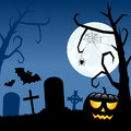 Halloween pumpkin and cemetery night scene background with the moon over a creepy graveyard with a trees gravestones bats flying Stock Photography