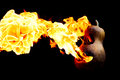 Halloween pumpkin on fire isolated on a black background Royalty Free Stock Photo