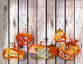 Halloween pumpkin five different pumpkins over wood background Stock Photos