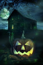 Halloween pumpkin in front of a Spooky house Royalty Free Stock Image