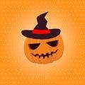 Halloween pumpkin in a hat on yellow