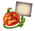 Halloween pumpkin head character with human expression and green plant hands holding an old grunge blank banner sign as a jack o Stock Photo