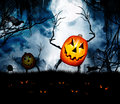 Halloween pumpkin king ghouls a ghoulish wave scary stick hands in a grave yard with ravens and a stormy cloudy sky Royalty Free Stock Photo