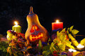 Halloween pumpkin lantern with autumn leaves and candies Stock Photography