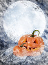 Halloween pumpkin lantern on full moon background Stock Photography