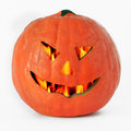 Halloween pumpkin lantern or jack o with a scary cut out face and a flaming interior closeup on a white background Stock Images