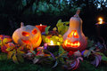 Halloween pumpkin lantern lanterns with autumn leaves and candies Stock Images