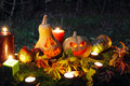 Halloween pumpkin lantern lanterns with autumn leaves and candies Royalty Free Stock Photo