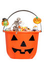 Halloween pumpkin pail filled with candy Royalty Free Stock Photos