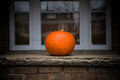 Halloween pumpkin sitting on a porch as fall decoration Stock Photos