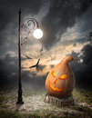 Halloween pumpkin and streetlamp on the stump Royalty Free Stock Photos