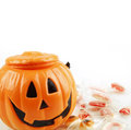 Halloween pumpkin and sweets on plain background Royalty Free Stock Photos