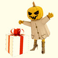 Halloween pumpkin witch has big gift illustration Stock Image