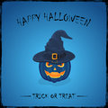 Halloween pumpkin in witch hat on blue background