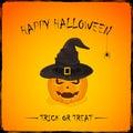 Halloween pumpkin in witch hat on orange background