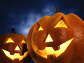 Halloween pumpkins on dark blue background d illustration Royalty Free Stock Photo