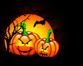 Halloween pumpkins with moon over dark Royalty Free Stock Photos
