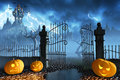 Halloween pumpkins next to a gate of a spooky castle jack o lanterns guarding an open leading high up in the mountains Stock Images