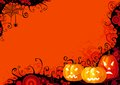 Halloween pumpkins three glowing and spider with web on abstract background Royalty Free Stock Image