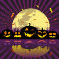 Halloween pumpkins under the moon Royalty Free Stock Photos