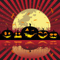 Halloween pumpkins under the moon Stock Image