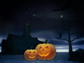 Halloween pumpkins under the tree Royalty Free Stock Photography