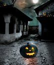Halloween pumpkins in the yard of an old house at night bright moonlight Stock Image